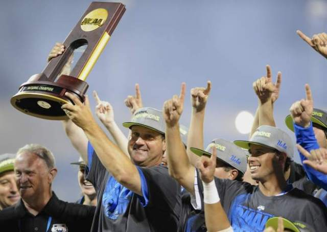 John Savage and the 2013 National Champion UCLA Briuns (AP photo)