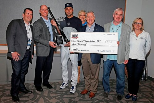 (L to R) Lawrence Writer, James Sass, Holly Clark, Rick Redman, John Hillerich and Lisa Hillerich all with Louisville Slugger make the presentations to Derek Jeter (photo courtesy New York Yankees)