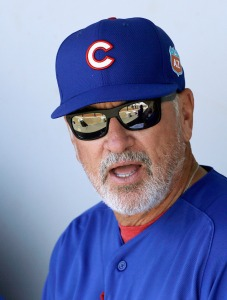 FILE - In this March 25, 2016 file photo, Chicago Cubs manager Joe Maddon waits for a spring training baseball game between the Cubs and the Milwaukee Brewers in Mesa, Ariz. Maddon's second season has begun with huge expectations after 97 wins in 2015 and a march to the NLCS that fueled hopes among long-suffering fans that a championship drought dating to 1908 is in its final stages. (AP Photo/Jeff Chiu, File)